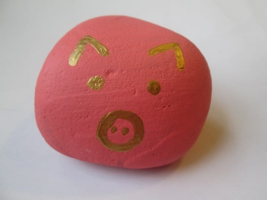 Lilly painted the rock and I added the cute pig face!