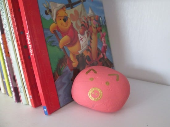Pig painted rock as a book end.  Works great!
